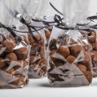 Luxury gifts with ribbon of chocolate truffles in a row — Stock Photo #61407017