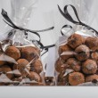Closeup on luxury bags of chocolate truffles with black ribbon — Stock Photo #61407029
