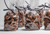 Luxury gifts with ribbon of chocolate truffles in a row — Stock Photo