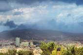 Dark clouds over the city of Barcelona — Stock Photo