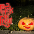 Trick or treat scary pumpkin in the gren grass — Stock Photo #56266701