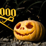 Boo Halloween scary pumpkin in the dark grass brushwood — Stock Photo #56267633