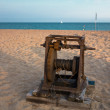 Постер, плакат: Old boat winch on the beach