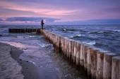 Sunset fisshing on breakwater  — Stock Photo