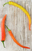 Red and yellow peppers background — Stockfoto