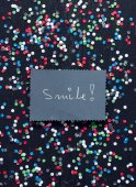 """Smile!"" handwritten card — Stock Photo"