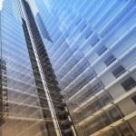 Blue clean glass wall of modern skyscraper — Stock Photo #53431063