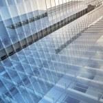 Blue clean glass wall of modern skyscraper — Stock Photo #53431065