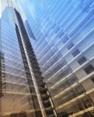 Blue clean glass wall of modern skyscraper — Stock Photo