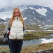 Young woman on the glacier. Mountain in Norway. — Stock Photo #61659593