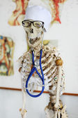 Skeleton in the medical cap on the skull with an endoscope — Stock Photo