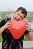 The man clenches with anger heart — Stock Photo