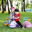 Little boy and girl quarrel over a toy car — Stock Photo #76299501