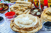 Pancakes with various fillings, caviar, mushrooms — Stock Photo