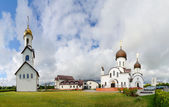 Church complex (Pokrovo- Nicholas Church, belfry and pilgrimage hotel), Klaipeda, Lithuania — Stock Photo