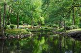Lithuania, Palanga. People walk in the Botanical park near pond — Foto de Stock