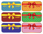 Colorful gift cards with ribbons — Stock Vector