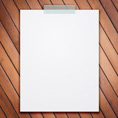 Empty white paper sheet stick on wood texture background. — Stock Photo