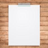 Empty white paper sheet stick on wood background. — Stock Photo