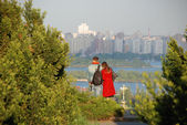 Young couple looking at the Dnipro — Stock Photo