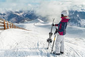 Young female skier admiring the stunning view — Stock Photo