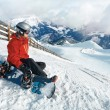 Snowboarder admiring the stunning view — Stock Photo #65367897