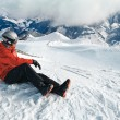 Snowboarder admiring the stunning view — Stock Photo #68677441