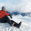 Snowboarder admiring the stunning view — Stock Photo #70174421