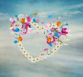 Flower heart flying on a background nature and sky with clouds — Stock Photo