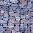 Stone fence protected by applicable Grids — Stock Photo #58250103