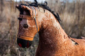 Close-up of the old thrown away rocking horse — Stock Photo