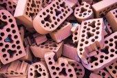 Pile of new intact and beaten bricks — Stock Photo