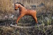 Old thrown away rocking horse — Stock Photo