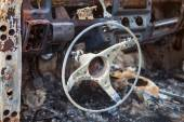 Burnt car interior with steering wheel after the accident — Stock Photo