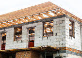 Unfinished house with timber roof truss — Foto de Stock