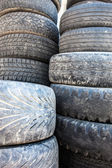 Stack of the old used tire covers. — Stock Photo