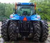 Rear view of the new blue tractor — Stock Photo