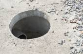 Manhole without cover in new concrete block  — Stock Photo