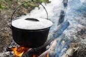 Cauldron on the open fire — Stock Photo