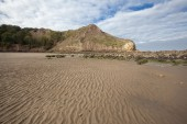 Textured sand and headlands at Cayton Bay — Stock Photo