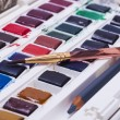 Artists watercolour paints and paint brush — Stock Photo #58220295