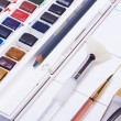 Artists watercolour paints and paint brush — Stock Photo #58220303