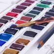 Artists watercolour paints and paint brush — Stock Photo #58220315