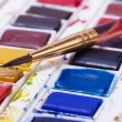 Artists watercolour paints and paint brush — Stock Photo #58220371