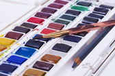 Artists watercolour paints and paint brush — Stock Photo