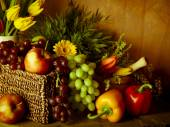 Traditional basket of harvested fruit and vegetables — Stock Photo