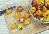 Tomatoes on a cutting board — Stock Photo