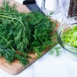 Dill on a cutting board — Stock Photo #71687353