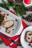 Roasted pork loin with cherries and spices on celebratory table — Stock Photo