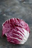 Radicchio red salad on wooden background. Vertical — Stockfoto